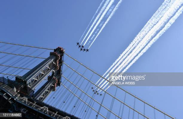 TOPSHOT The Blue Angels and Thunderbirds fly over New York in a salute to health care workers on April 28 2020 The US Navy Blue Angels and Air Force...