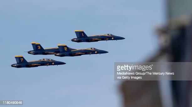 The Blue Angels fly past a sign promoting Fleet Week along the Embarcadero in San Francisco, Calif., on Thursday, Oct. 10, 2019. Fleet Week runs...