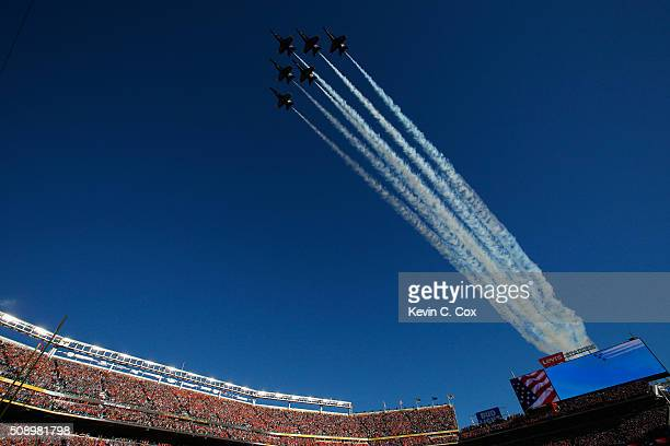 The Blue Angels perform a flyover prior to Super Bowl 50 between the Denver Broncos and the Carolina Panthers at Levi's Stadium on February 7 2016 in...