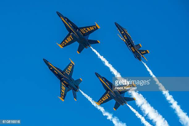 the blue angels perform a maneuver  at an air show. - blue angels stock pictures, royalty-free photos & images