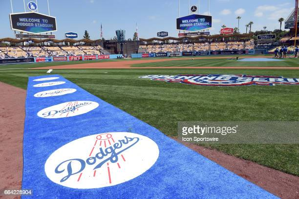 The blue carpet with the Dodgers logo and the video boards reading Welcome to Dodger Stadium during an MLB opening day game between the San Diego...