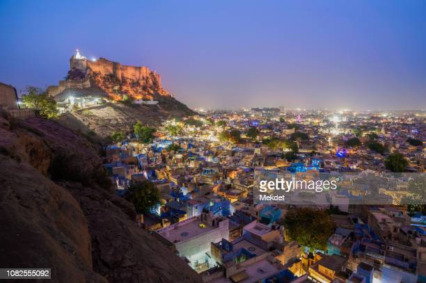 the blue city of jodhpur and the greatest mehrangarh fort at night, jodhpur, rajasthan, india - jodhpur stock pictures, royalty-free photos & images