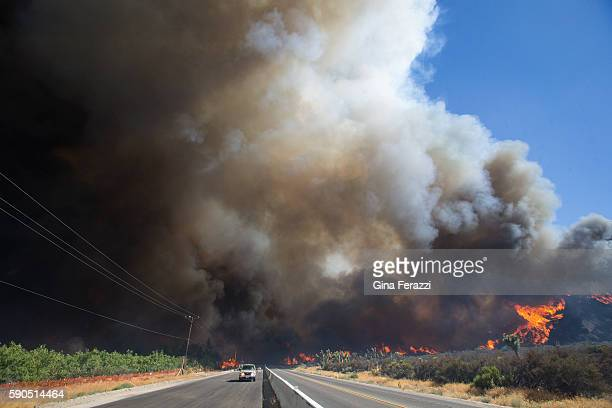 The Blue Cut Fire roars out of control towards on both sides of Highway 138 on August 16 2016 in Phelan California