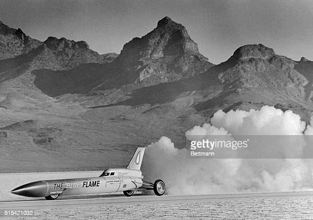 The Blue Flame blasts away from the starting point here during practice run for an assault on the world land speed record the car burns smokeless...
