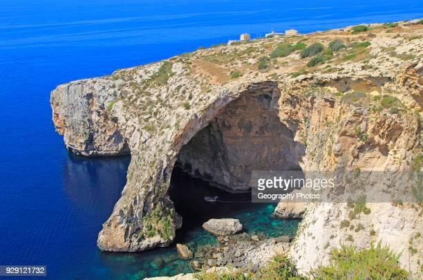 The Blue Grotto natural sea arch and cliffs, Wied iz-Zurrieq, Malta.