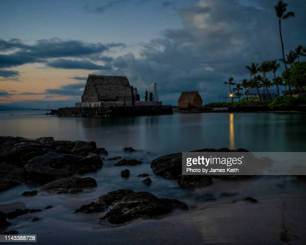 """the """"blue hour"""" before sunrise and all is calm on the lagoon of a tropical island. - kailua stock pictures, royalty-free photos & images"""