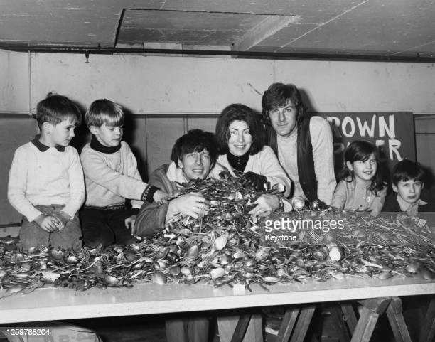 The 'Blue Peter' presenting team with some of the forks and spoons which had been donated as part of Blue Peter's Christmas Appeal, with...