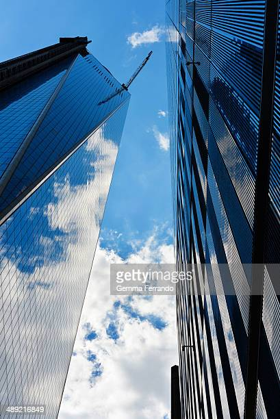 The blue sky and white clouds reflected in the glass of World Trade Center new building in Ground Zero, New York City.