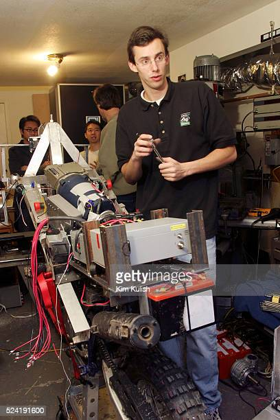 The Blue Team member Anthony Levandowski works on their robotic motorcycle inside a tiny home garage in preparation of the DARPA Grand Challenge The...