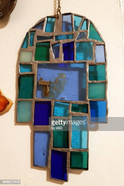 the blue vitrail glass hamsa symbol, close-up - hand of fatima stock photos and pictures