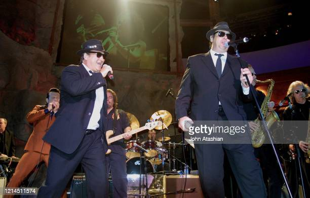 The Blues Brothers Jim Belushi and Dan Aykroyd are shown performing on stage during a live concert appearance on June 21 2002