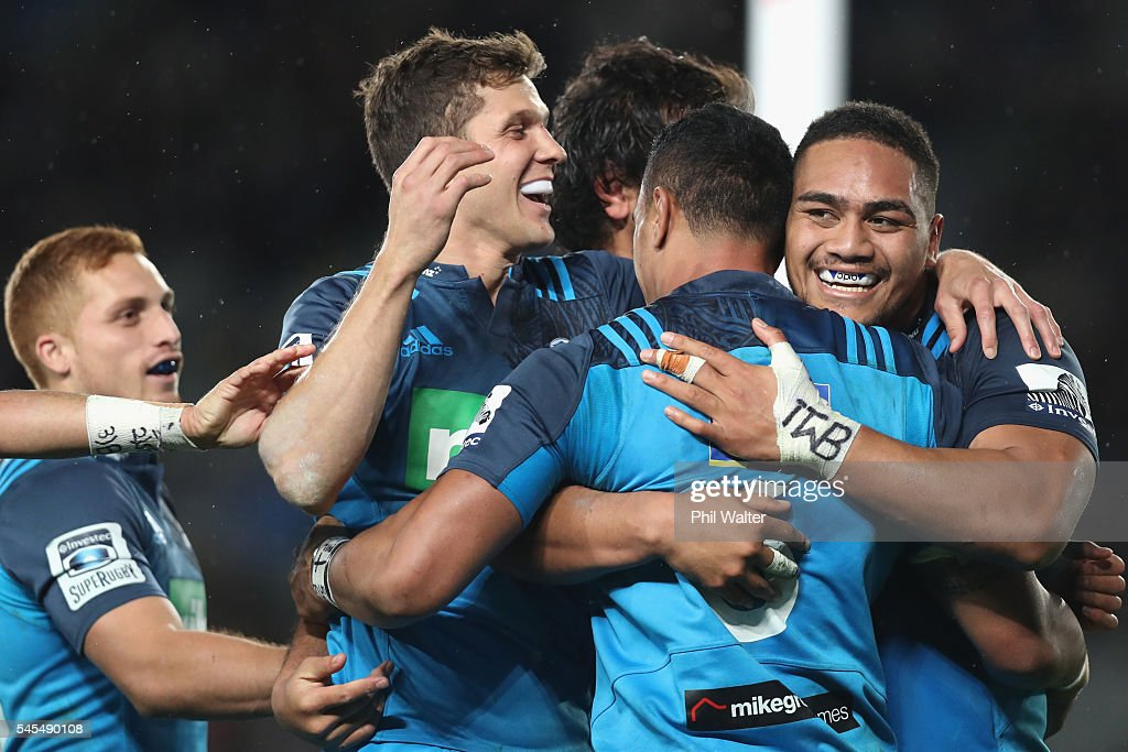 The Blues celebrate a try to Jerome Kaino (C) during the round 16 Super Rugby match between the Blues and the Brumbies at Eden Park on July 8, 2016 in Auckland, New Zealand.