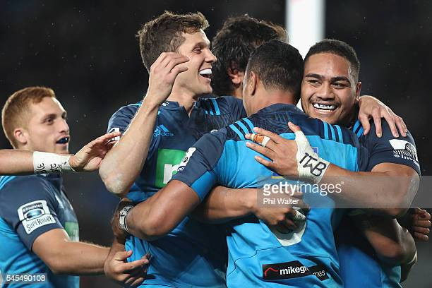 The Blues celebrate a try to Jerome Kaino during the round 16 Super Rugby match between the Blues and the Brumbies at Eden Park on July 8 2016 in...