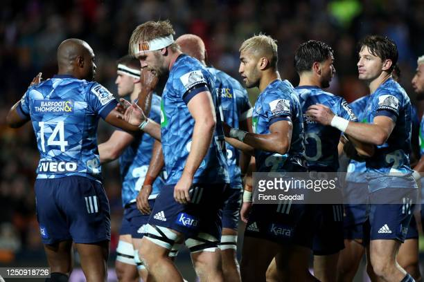The Blues celebrate after Hoskins Sotutu of the Blues scored a try during the round 2 Super Rugby Aotearoa match between the Chiefs and the Blues at...