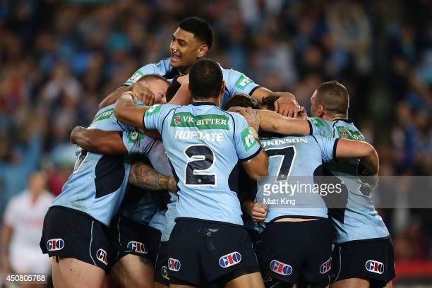The Blues celebrate after Trent Hodkinson of the Blues scores a try during game two of the State of Origin series between the New South Wales Blues...