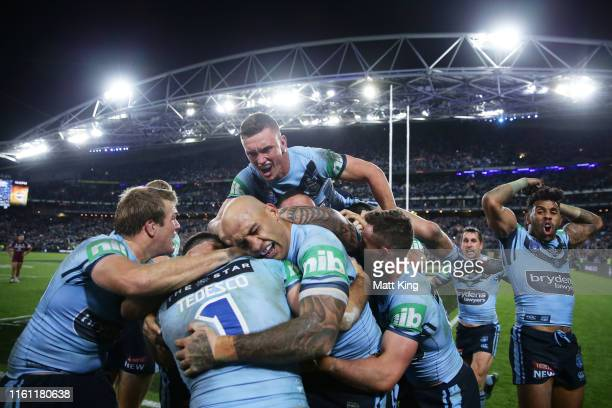 The Blues celebrate victory at the end of game three of the 2019 State of Origin series between the New South Wales Blues and the Queensland Maroons...