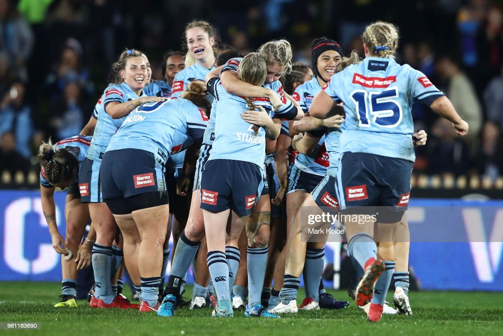 The Blues celebrate victory during the Women's State of Origin match between New South Wales and Queensland at North Sydney Oval on June 22, 2018 in Sydney, Australia.
