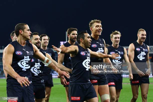 The Blues celebrate victory in the round 3 AFL match between the Geelong Cats and the Carlton Blues at GMHBA Stadium on June 20, 2020 in Geelong,...