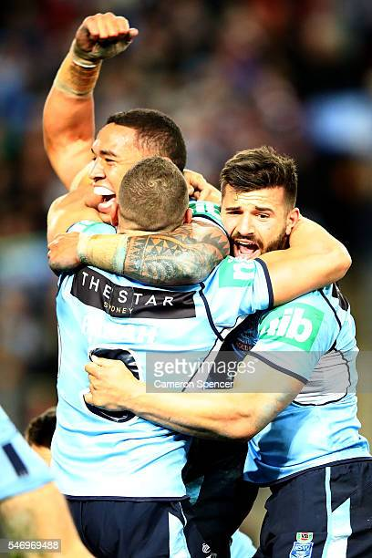 The Blues celebrate winning game three of the State Of Origin series between the New South Wales Blues and the Queensland Maroons at ANZ Stadium on...