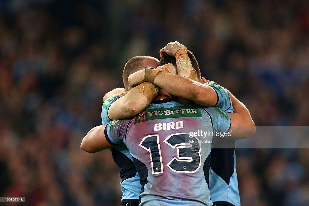 The Blues celebrate winning the series after winning game two of the State of Origin series between the New South Wales Blues and the Queensland Maroons at ANZ Stadium on June 18, 2014 in Sydney, Australia.