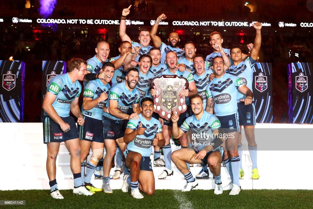 The Blues celebrate with the shield after a series win after game three of the State of Origin series between the Queensland Maroons and the New South Wales Blues at Suncorp Stadium on July 11, 2018 in Brisbane, Australia.