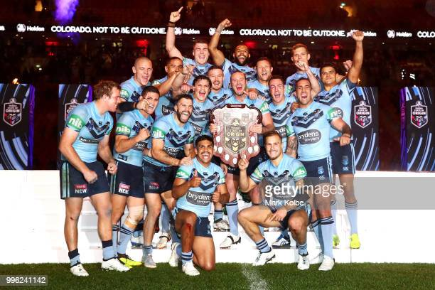 The Blues celebrate with the shield after a series win after game three of the State of Origin series between the Queensland Maroons and the New...