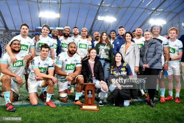 The Blues hold the Gordon Hunter Memorial Trophy after winning the round 8 Super Rugby Aotearoa match between the Highlanders and the Blues at...