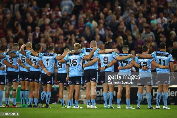 The Blues lineup and sing the National Anthen before game three of the State Of Origin series between the Queensland Maroons and the New South Wales...