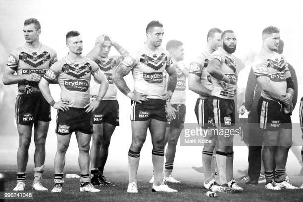 The Blues look dejected after defeat during game three of the State of Origin series between the Queensland Maroons and the New South Wales Blues at...