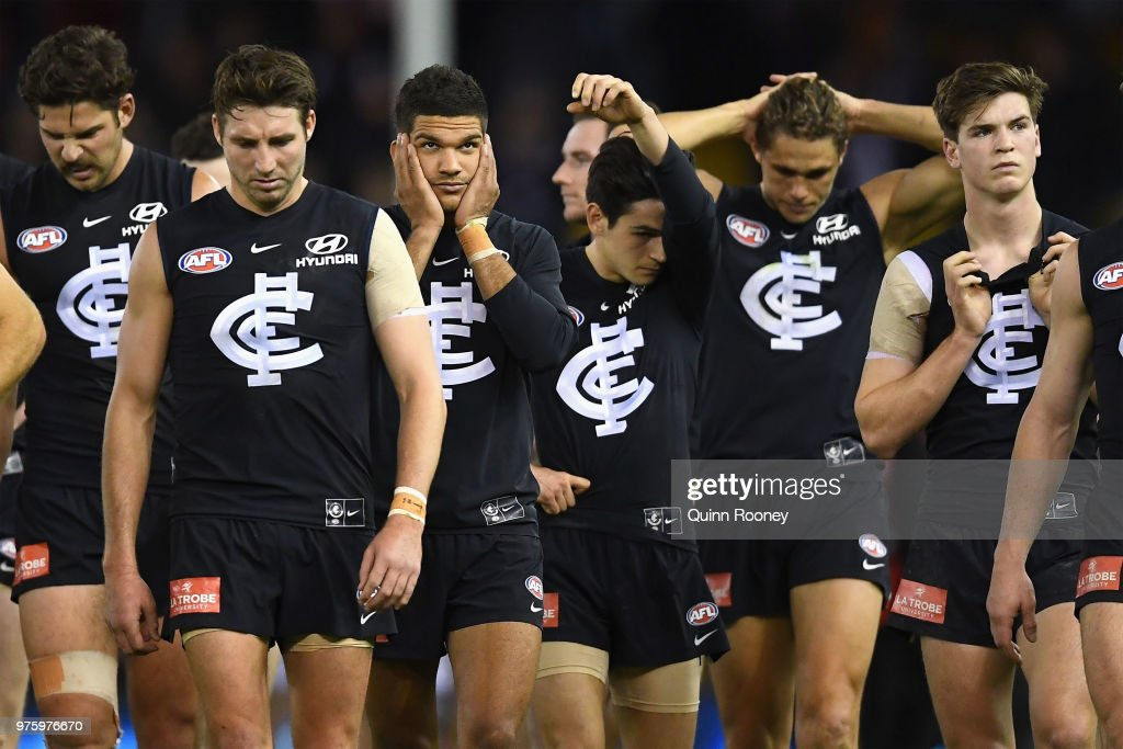 The Blues look dejected after losing the round 13 AFL match between the Carlton Blues and the Fremantle Dockers at Etihad Stadium on June 16, 2018 in Melbourne, Australia.