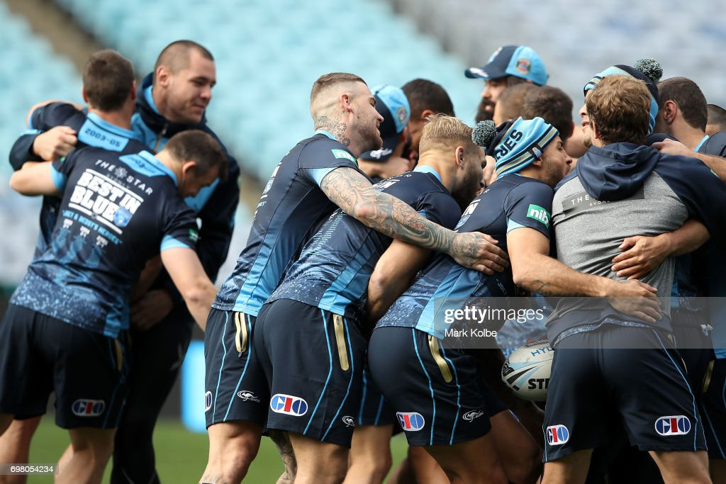The Blues players laugh as they form a huddle during a New South Wales Blues State of Origin captain's run at ANZ Stadium on June 20, 2017 in Sydney, Australia.