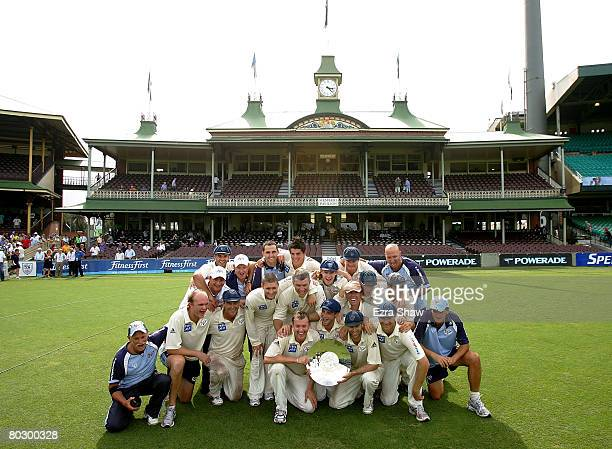 The Blues pose with the trophy after their victory on day five of the Pura Cup Final match between the New South Wales Blues and the Victorian...