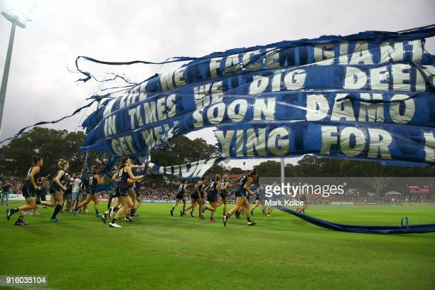 The Blues run out during the round 20 AFLW match between the Greater Western Sydney Giants and the Carlton Blues at Drummoyne Oval on February 9 2018...