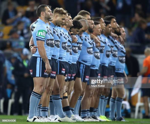 The Blues stand for the national anthem during game three of the State of Origin series between the Queensland Maroons and the New South Wales Blues...