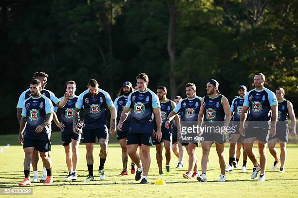 The Blues walk to a drinks break during a New South Wales Blues State of Origin training session on May 25 2016 in Coffs Harbour Australia
