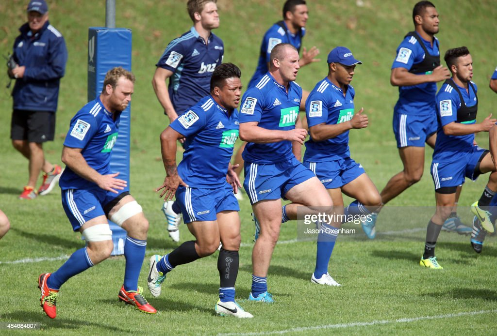 The Blues warm up before an Auckland Blues Super Rugby training session at Unitec on April 14, 2014 in Auckland, New Zealand.