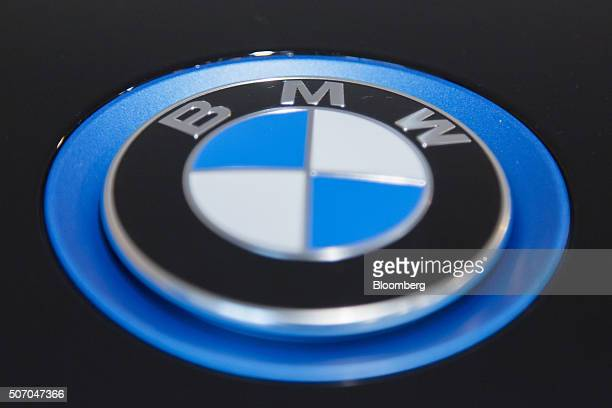 The BMW badge sits on an i3 plugin automobile produced by Bayerische Motoren Werke AG inside the BMW World showroom in Munich Germany on Tuesday Jan...