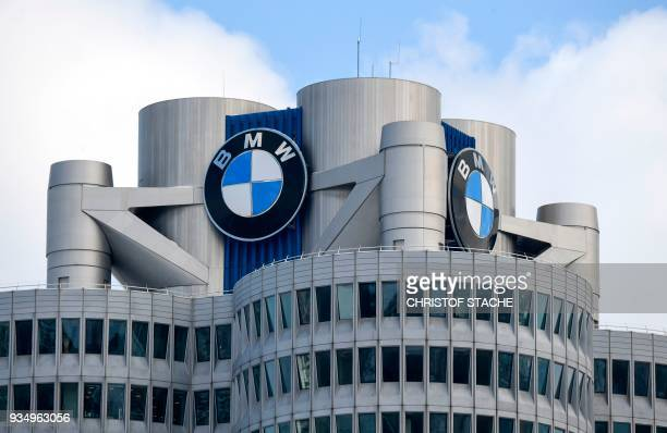 The BMW logo is seen on the top of the headquarters of German carmaker BMW in Munich on March 20 2018 The company's annual press conference will take...