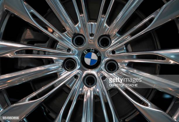 The BMW logo on a wheel rim is pictured at the 'BMW World' delivery center near the company's headquarters in Munich on March 20 2018 The company's...