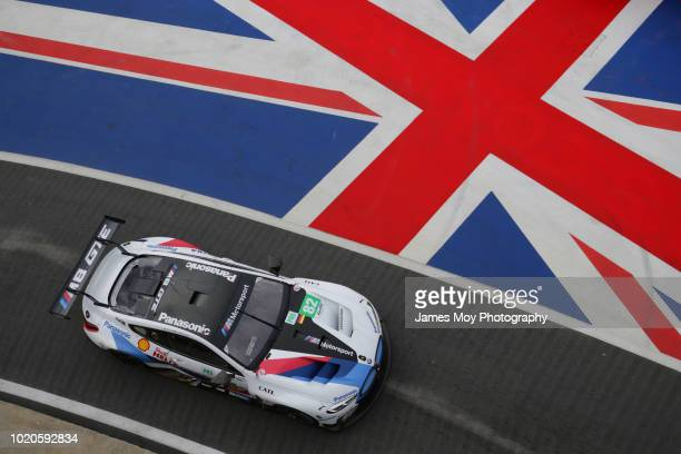 Fernando Alonso of Spain and The Toyota Gazoo Racing Team with team mate SEbastien Buemi of Switzerland at Silverstone Circuit on August 16 2018 in...