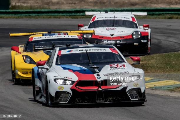 The BMW M8 GTE of Alexander Sims of Great Britain and Connor De Phillippi leads a pack of cars during the Michelin GT Challenge IMSA WeatherTech...
