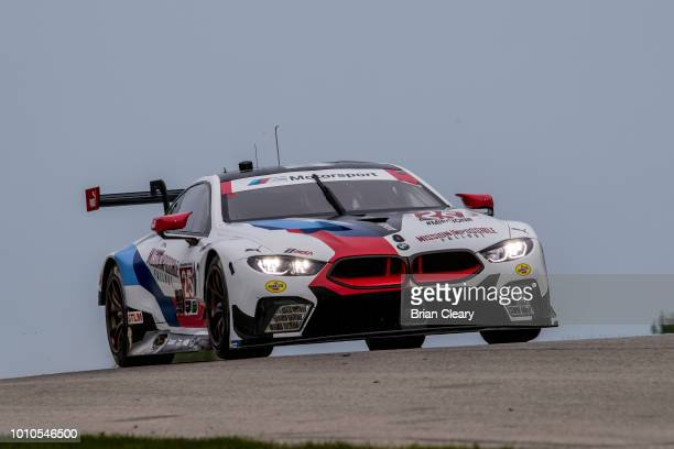 The BMW M8 GTE of Alexander Sims of Great Britain and Connor de Phillippi races on the track during practice for the IMSA Continental Road Race...