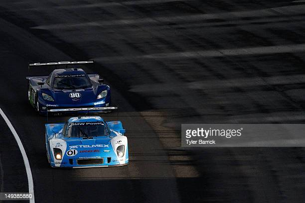 The BMW Riley driven by Scott Pruett and Memo Rojas leads the Corvette DP driven by Antonio Garcia and Richard Westbrook during the GrandAM Rolex...