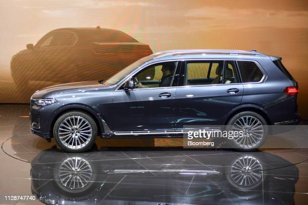 The BMW X7 xdrive 40i automobile sits on display on the Bayerische Motoren Werke AG exhibition stand on the opening day of the 89th Geneva...