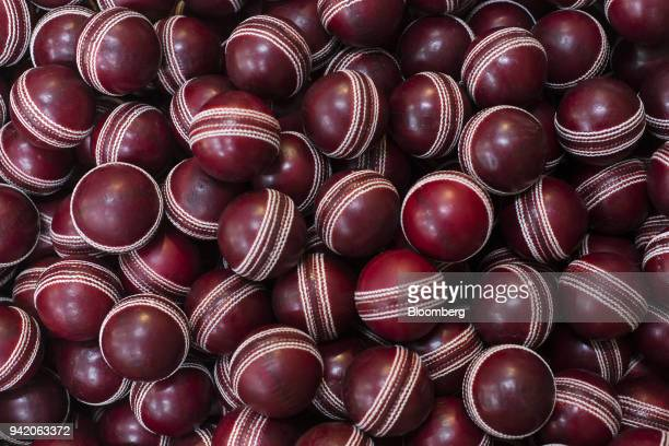 The Board of Control for Cricket in India approved red cricket balls sit ahead of being branded at a Sanspareils Greenlands Pvt factory in Meerut...