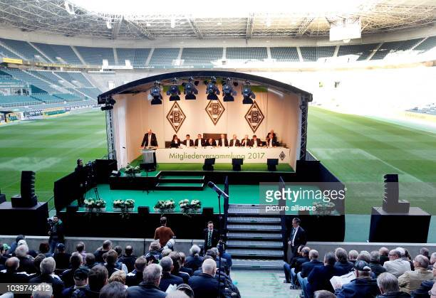 The board of the German Bundesliga team Borussia Moenchengladbach sits on stage during the annual general meeting in Moenchengladbach Germany 3 April...