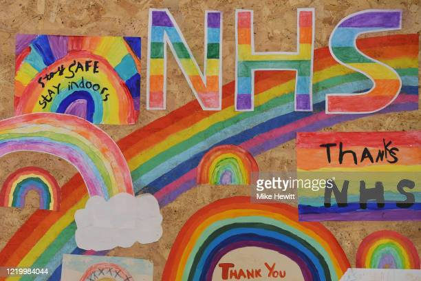 The boarded up Ginger Dog pub is covered in supportive messages for the NHS on April 20, 2020 in Brighton, United Kingdom. The British government has...