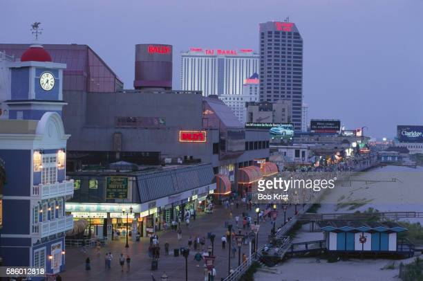 the boardwalk at dusk - atlantic city stock pictures, royalty-free photos & images