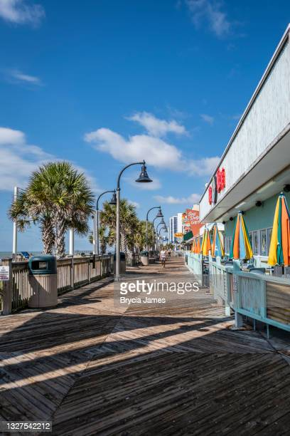 the boardwalk at myrtle beach - brycia james stock pictures, royalty-free photos & images