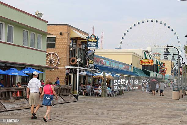 The boardwalk lures the hungry the thirsty souvenirhunters and thrillseekers to downtown Myrtle Beach